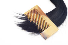 Black hair and comb Stock Photography