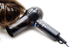Black hair drier with wig Stock Photos