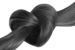 Black hair knot in shape of heart, isolated on white