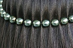 Black hair with pearl string Stock Photo