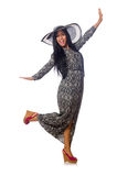 The black hair woman in long gray dress and hat isolated on white Stock Photography