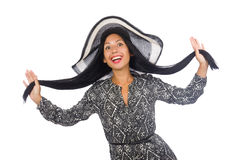 The black hair woman in long gray dress and hat isolated on white Royalty Free Stock Photography