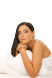 Black haired Beauty in Bed Stock Images