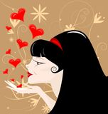 Black-haired girl. On an abstract brown background black-haired girl sends kisses Stock Photo