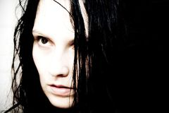 Black haired girl. Creepy portrait of gothic girl Stock Photography