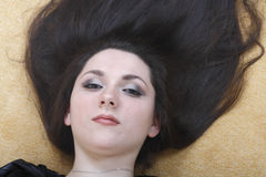 Black-haired girl with her hair Stock Photos