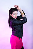 Black haired girl in leather jacket Royalty Free Stock Image