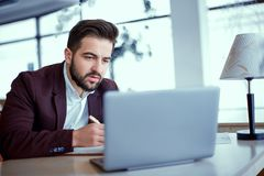 A man works at a laptop royalty free stock photos
