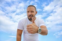 Black Haired Man in White Crew Neck T-shirt Royalty Free Stock Image