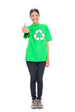 Black haired model wearing recycling tshirt giving thumb up. On white background Royalty Free Stock Photos