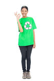 Black haired model wearing recycling tshirt making okay gesture Royalty Free Stock Photo
