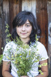 Black-haired teen girl with a bouquet of greenery Royalty Free Stock Images