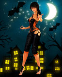 Black haired witch dancing under the moon Royalty Free Stock Image