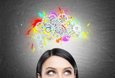 Black haired woman and brain with gears Royalty Free Stock Photo