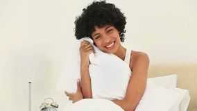 Black haired woman holding her pillow