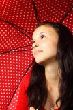 Black Haired Woman in Red Sweater Wearing Silver Dog Pendant Necklace Holding Black Red White Polka Dotted Umbrella Stock Photos