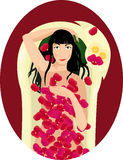 Black haired woman takes a bath with rose petals Stock Images