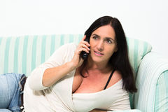 Black Haired Woman Talking On Phone Stock Photos
