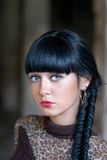 Black haired women with braid fashion style outdoors Royalty Free Stock Photography
