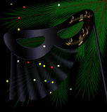 Black half mask and tree Royalty Free Stock Image