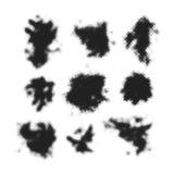 Black halftone blots. Set of black halftone blots and ink splashes isolated on white background Stock Images