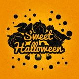 Black Halloween on an orange background. Sweet, happy Halloween poster, postcard. Pumpkins, witches cauldron, potion. Black Halloween on an orange background Royalty Free Stock Photo