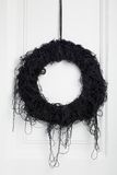 Black halloween twig wreath Stock Photos