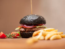 Black hamburger with squid ink Stock Images