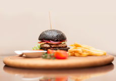 Black hamburger with squid ink Stock Image