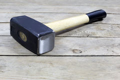 Black Hammer With Wooden Handle On Wooden Background Stock Images