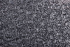 Black hammered metal background,abstract metalic texture, sheet of metal surface painted with hammer paint Royalty Free Stock Image