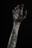 Black hand of death, the walking dead, zombie theme, halloween theme, zombie hands, black background, mummy hands Stock Photos