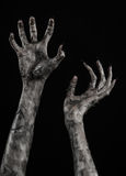 Black hand of death, the walking dead, zombie theme, halloween theme, zombie hands, black background, mummy hands Royalty Free Stock Image