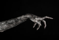 Black hand of death, the walking dead, zombie theme, halloween theme, zombie hands, black background, mummy hands Stock Image