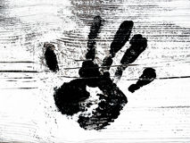 Black hand print painted. Painted black hand print on white background royalty free stock photography