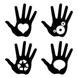 Black hand prints with idea symbols Royalty Free Stock Image