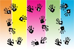 Black hand prints made by children. On gradient pastel stripes Royalty Free Stock Image