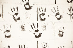 Black hand prints in wall Royalty Free Stock Photos
