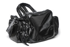 Black handbag. A female black handbag on isolated white background Royalty Free Stock Images