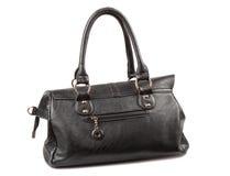 Black handbag. On the white background Stock Photos