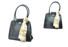 Black handbag with beige silk scarf. Isolated on white Royalty Free Stock Photography