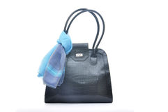 Black handbag with blue silk scarf Royalty Free Stock Photos