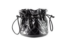 Black handbag for cosmetics with a white fringing on a white background Royalty Free Stock Photos