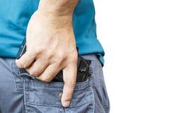 Black handgun in rear pocket Stock Image
