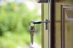 Black Handled Key on Key Hole Stock Photography