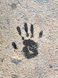 Black Handprint on the ground stock photography