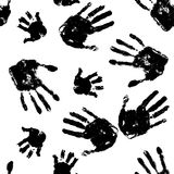 Black handprints on white background pattern. Horror seamless background. Social illustration Stock Photography