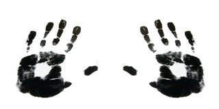 Black hands. Black hand-prints against a white background Stock Photos