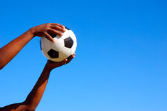Black hands catching soccer ball Royalty Free Stock Photography