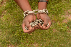 Black hands in chains Royalty Free Stock Photo